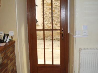 Porte d'entrée PVC imitation bois